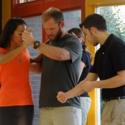 Dance teacher adjusting students