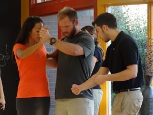 Dance teacher adjusting students in Arizona
