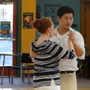Teacher and student dancing
