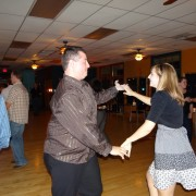 a couple swing dancing